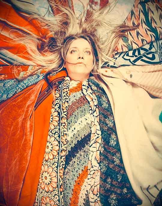 Jenny Allen wrapped in blankets