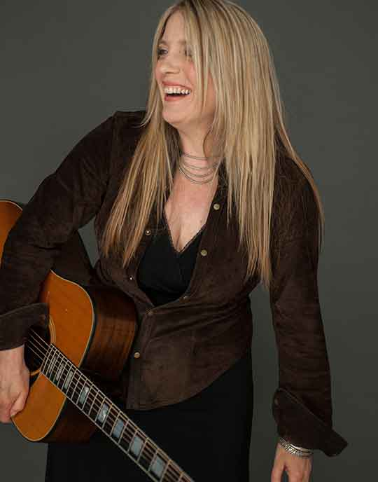 Jenny Allen with guitar